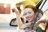 Happy woman, buyer sitting in her new blue car showing keys  — Stock Photo