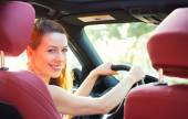 Happy woman driving her new car — Stock Photo