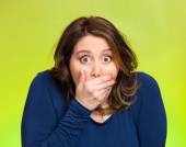 Shocked young woman, covering her mouth — Stock Photo