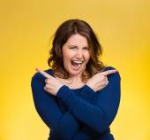Woman pointing in two different directions, stressed, frustrated — Stock Photo