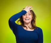 Woman placing hand on head, palm on face gesture in duh moment — Stock Photo