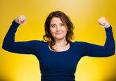 Woman flexing muscles showing, displaying her strength — Стоковое фото