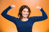 Woman flexing muscles showing, displaying her strength — Stock Photo