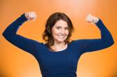 Woman flexing muscles showing, displaying her strength — Foto Stock