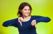 Woman showing thumbs down hand gesture, happy someone made mistake — Stok fotoğraf