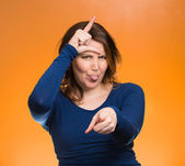 Mad pissed off woman, showing loser sign — Stock Photo