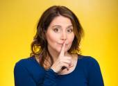 Female showing hand silence sign — Stock Photo