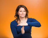 Serious woman showing time out gesture with hands — Stock Photo