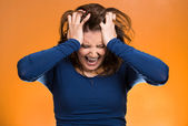 Stressed business woman, pulling her hair out — Stockfoto