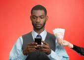 Man texting, on smart phone, ignoring offered money — Stock Photo