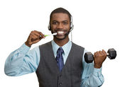 Business man talking on phone, brushing teeth, lifting dumbbell — Stock Photo