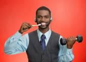 Business man talking on phone, brushing teeth, lifting dumbbell — Stock Photo