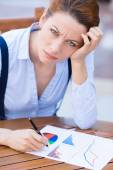 Unhappy business woman looking displeased working on financial report  — Stock Photo