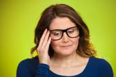 Mature, shy, sad woman playing nervously with glasses — Stock Photo