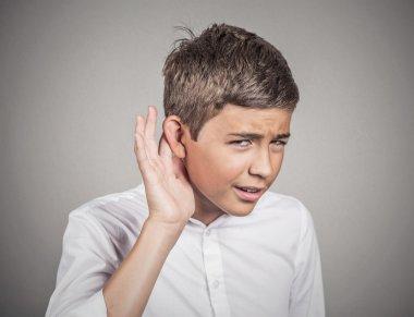Hard of hearing man placing hand on ear asking to speak up