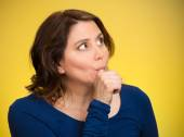 Woman with finger in mouth, sucking thumb — Stock fotografie