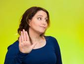 Grumpy woman with bad attitude, giving talk to my hand gesture — Foto Stock