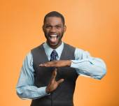 Angry business man showing time out gesture with hands — Stock Photo
