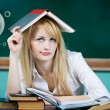 Daydreaming student, female teacher — Stock Photo #52786535