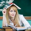 Student sitting at desk in classroom, looking upwards, confused, thinking — Stock Photo #52786563