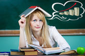Student, teacher, daydreaming to repay her loan — Stock Photo