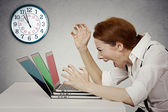 Angry businesswoman screaming at computer, pressured by lack of time — Stock Photo