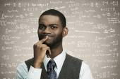 Confused business man thinking deeply about something, looking puzzled — Stock Photo