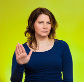 Annoyed woman with bad attitude, giving talk to hand gesture — Stock Photo