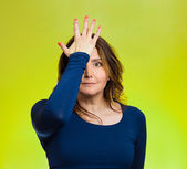 Woman realizes mistake, slapping hand on head to say duh, — Stock Photo