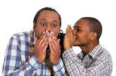 Guy whispering into man's ear, men spread rumor — Stock Photo