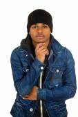 Handsome young man, posing fashion model, dressed in jeans — Stock Photo
