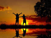 Silhouette happy excited carefree couple looking at sunset — Stock Photo