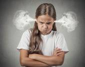 Angry young girl Blowing Steam from ears — Стоковое фото
