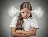 Angry young girl Blowing Steam from ears — Stock Photo