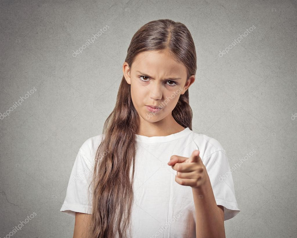 Angry child bossy teenager girl pointing finger at someone ...
