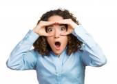 Curious woman peeking, looking surprised — Stock Photo