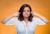 Woman plugging ears annoyed by loud noise ignoring someone  — Stock Photo