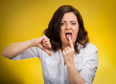 Woman showing Disgust thumbs down gesture — Stock Photo