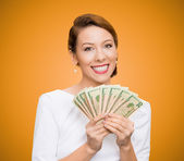 Successful young business woman holding money — Stock Photo