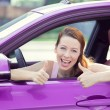Woman driver happy smiling showing thumbs up — Stockfoto #53615077