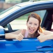 Woman driver happy smiling showing thumbs up — Stock Photo #53615081