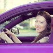 Happy woman, buckled up, driving car — Stock Photo #53615305