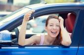 Woman, buyer sitting in her new car showing keys  — Stock Photo