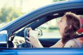 Sleepy, tired, fatigued, woman driving her car — Stockfoto