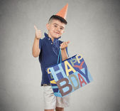 Birthday child boy with gift box, bag showing thumbs up — Stock Photo
