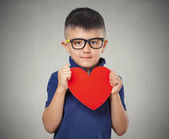 Child holds red heart — Stock Photo