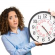 Woman, worker, holding clock looking anxiously, pressured by lack of time — Stock Photo #53687833