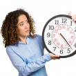 Woman, worker, holding clock looking anxiously, pressured by lack of time — Stock Photo #53687835