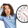 Woman, worker, holding clock looking anxiously, pressured by lack of time — Stock Photo #53687837