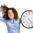 Woman, worker, holding clock looking anxiously — Stock Photo #53687849